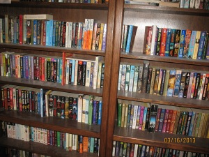 two of the bedroom bookcases, mostly humorous SPEC fic in alphabetical order by author or editor's last name