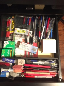Drawer packed full of pens